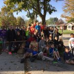 Grade 6 students ready to rake leaves in the neighbourhood.