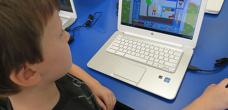 A student uses a UGDSB Chromebook in a public library