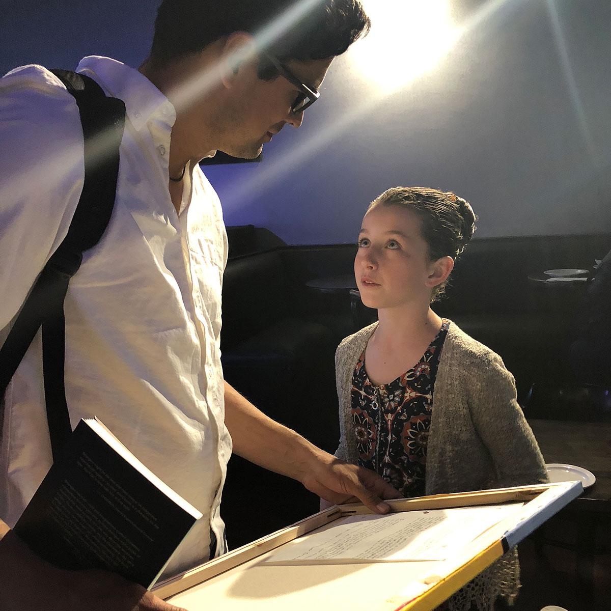 John Black PS student Eliina presents a painting to author David Robertson, May 14, 2018.