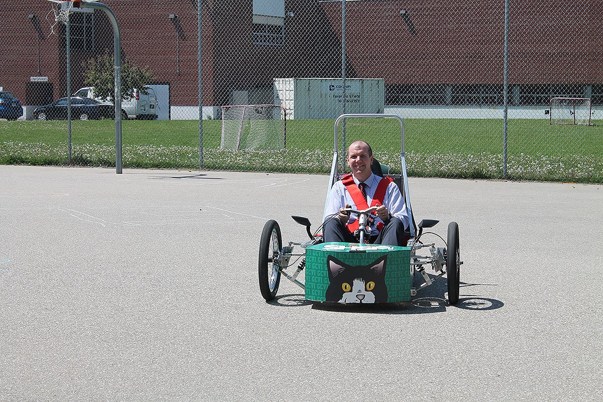GCVI Principal Robert Scott takes a spin in the school's electric vehicle, May 28, 2018.