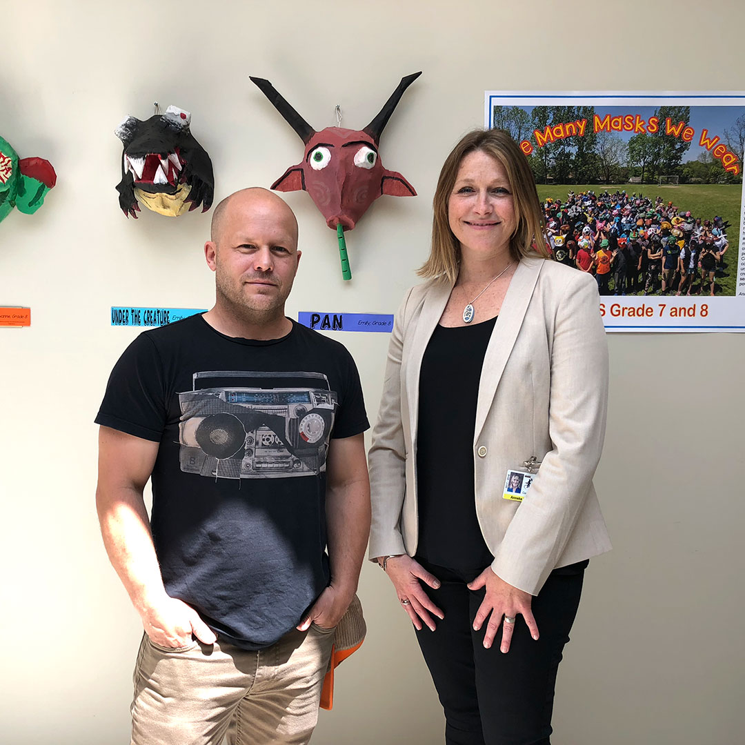 "Art teacher O'Neil Ford and UGDSB Curriculum Lead Anneke McCabe at the opening reception for ""The Many Masks We Wear"" - a student art exhibit by John Galt Public School. June 12, 2018."