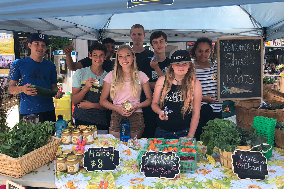 Students from the Young Urban Farmers project sell their locally grown produce at the Wednesday Market in downtown Guelph on July 25, 2018.