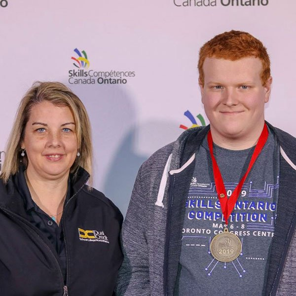 Tyler and coach Joanne Harris at Skills Ontario 2019.