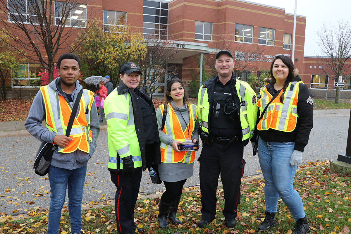 Walking School Bus Leaders and Guelph Police pictured at Mitchell Woods Public School on Oct. 31, 2019.