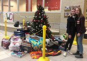 CWDHS students are pictured next to a Christmas tree and gifts they collected for members of the community (December 2019).