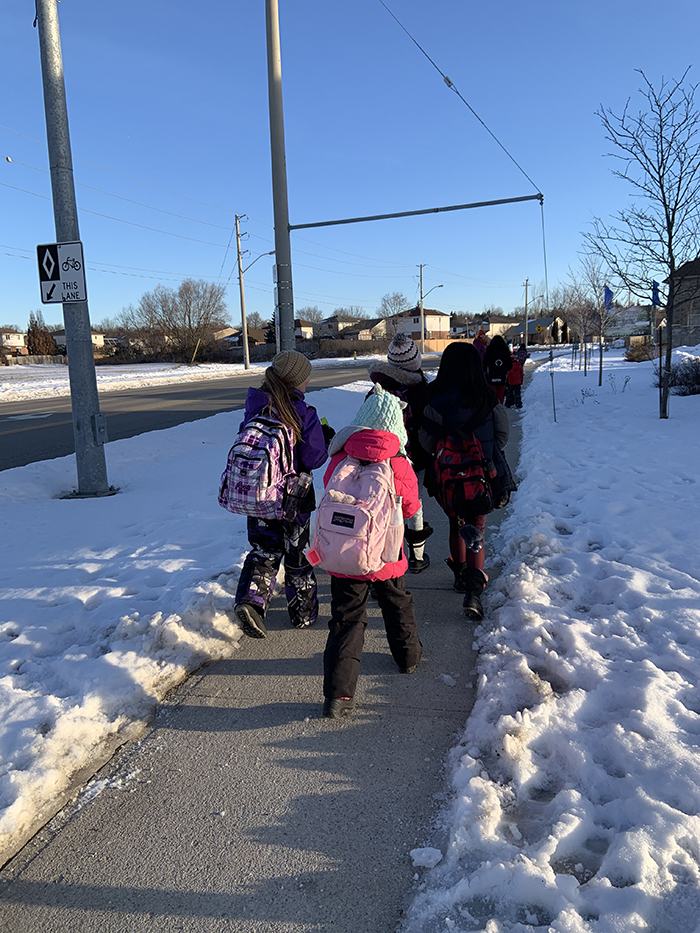 Students and staff bundled up for Winter Walk Day