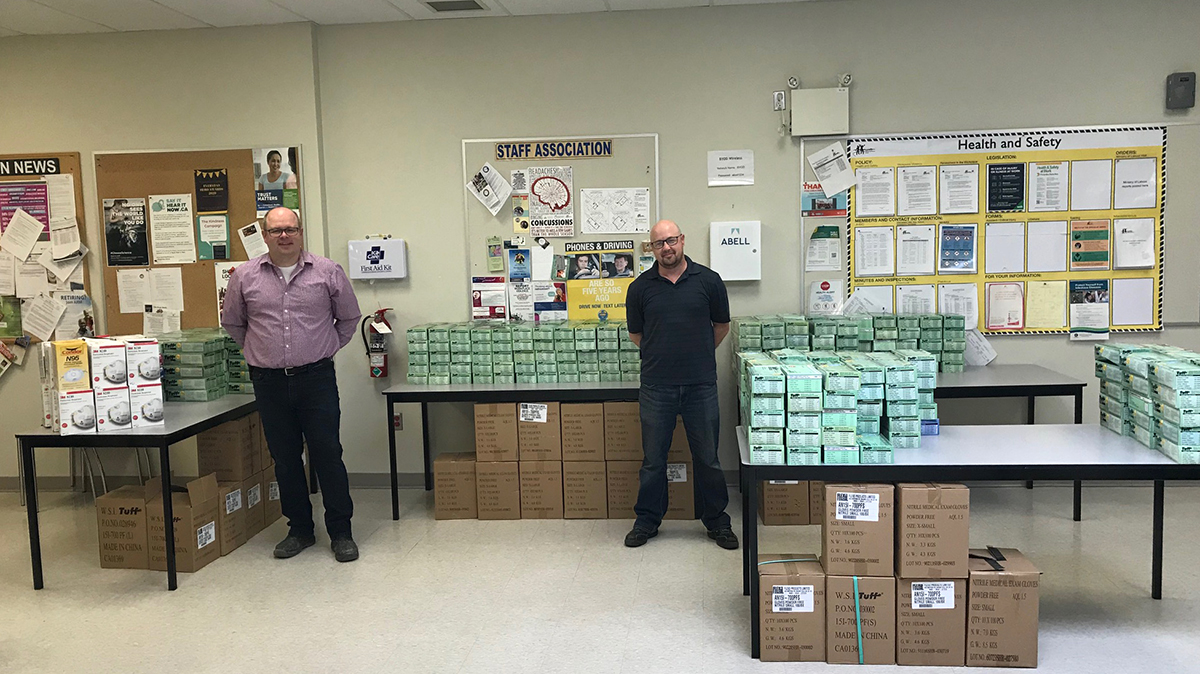 Staff at the UGDSB Guelph Board Office are pictured with boxes of PPE supplies including gloves and masks on March 30, 2020.
