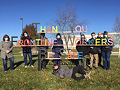 WHSS staff and students pictured next to a wooden sign the made to thank frontline workers.